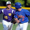 Mankato Twins shortstop Todd Standish runs down Chaska's Tony Lane during the fifth inning of their super section game Saturday at the Chaska Athletic Park.