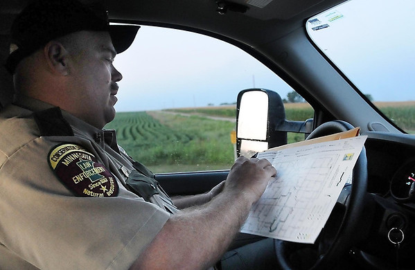 Bob Geving double checks the 25-mile route he will drive to tally the number and species of wildlife he sees.
