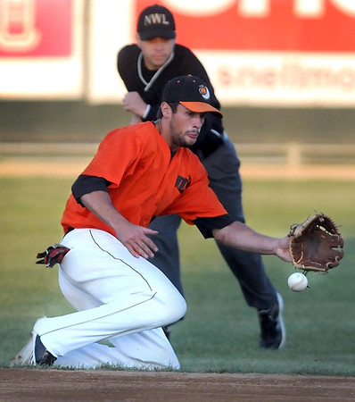 Mankato MoonDogs shortstop Chad Christensen slides to keep a ground ball in the infield during their Northwoods League Championship Series game against La Crosse Thursday at Franklin Rogers Park.
