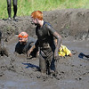 John Cross<br /> Mud Run participants struggle through a mud pit near the end of the Mankato Mud Run.