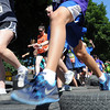 John Cross<br /> Runners pick their way through an obstacle of tires at the Mankato Fun Run.