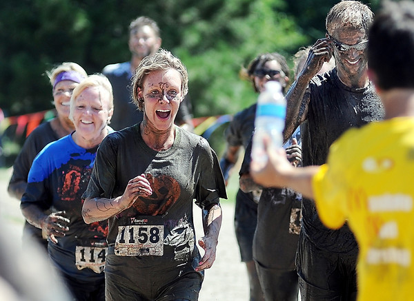 John Cross<br /> Mankato Mud Run participants close in on the finish line and cold water.