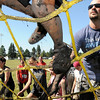 John Cross<br /> Mankato Mud Run participants scramble over an obstacle of ropes.