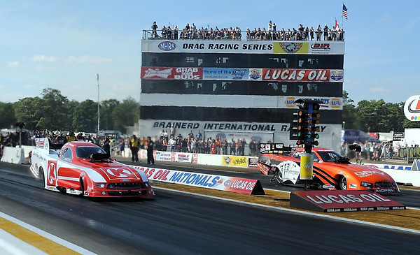 Pat Christman <br /> Funny car drivers Tim Wilkerson (left) and Johnny Gray leave the starting line during a qualifying round of the Lucas Oil Nationals Saturday in Brainerd.