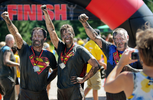 John Cross<br /> Muddy but victorious, the Kasota team of Bob Kamm (left), daughter, Kaitlin, and father, Bob Sr.,  pose for a photograph after successfully completed the Mankato Mud Run.