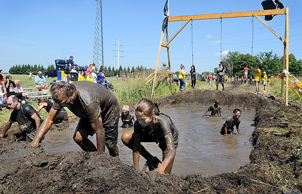 John Cross<br /> A rope swing into a mud pit posed one last obstacle for Mankato Mud Run contestants.