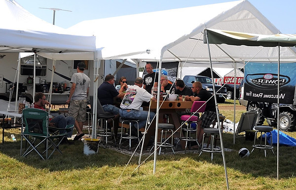 Pat Christman <br /> A group of NHRA fans set up camp in the family camping area at Brainerd International Raceway during the Lucas Oil NHRA Nationals Friday.