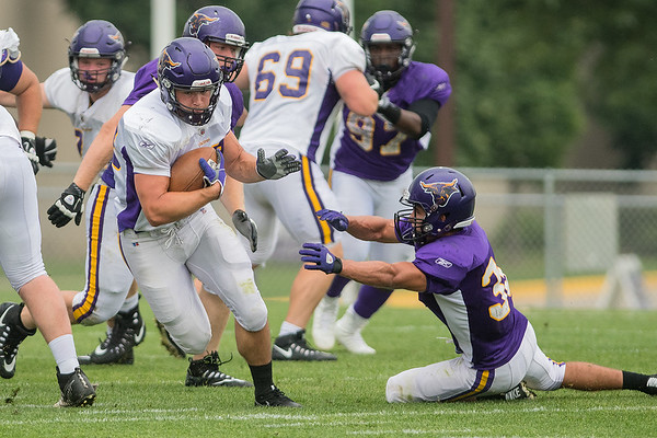Minnesota State's Ian Pribyl (left) eludes a defender during a scrimmage held on Wednesday. Photo by Jackson Forderer