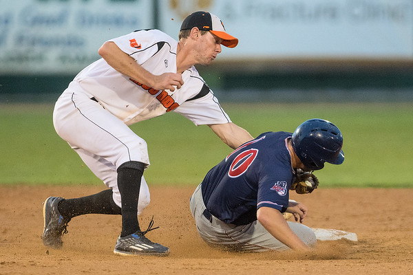 Mankato MoonDogs shortstop Ryan Kreidler tags out Drew Avans (10) of the St. Cloud Rox during Tuesday's game at Franklin Rogers Park. Photo by Jackson Forderer