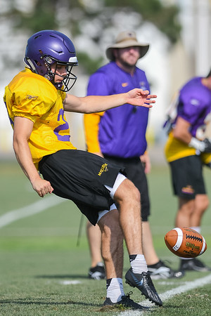 Minnesota State freshman Luke Williams gets a punt off during scrimmage at practice on Wednesday. Photo by Jackson FordererPhoto by Jackson Forderer