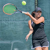 Hannah Weng of Mankato East watches her forehand hit to her opponent Emily Tuchtenhagen of Sibley East. Weng won her match 6-0 against Tuchtenhagen in the Mankato East Invitational on Friday. Photo by Jackson Forderer