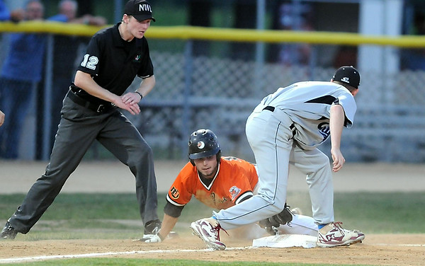 The Mankato MoonDogs' Ridge Smith can't keep his hand on third base as he is tagged out by the Chinooks' Blake Butler during the fifth inning of the Summer Collegiate World Series game Thursday at Franklin Rogers Park.  Photo by Pat Christman