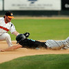 Rochester's Alex Schultz beats the tag of Moondog Brett Synek to safely steal second base during action at Franklin Rogers Park on Thursday. Photo by John Cross
