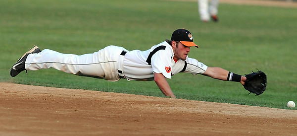 Mankato MoonDogs second baseman Brett Synek dives for a ground ball during the fourth inning of a game against Duluth Thursday at Franklin Rogers Park. Photo by Pat Christman