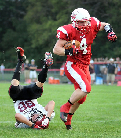 New Prague's Jason Kazlauskas can't stop Mankato West's Trenton Marks from getting into the end zone during their game Thursday.