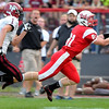 Mankato West's Will Claussen makes a fingertip catch ahead of New Prague's Joe Kneip during the first half Thursday at Todnem Field.