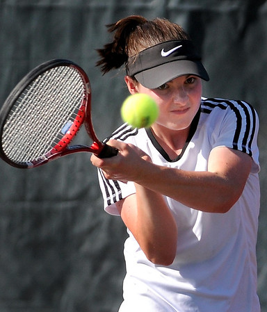 Mankato East's Katie Karkoska returns a volley during her singles match Wednesday at the East courts.