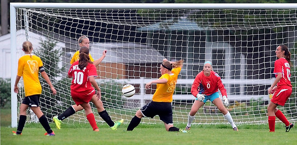 Mankato West's Sarah Buryska (10) takes a shot that finds the net behind Mankato East goalie Kelsey Ekstedt (0) near the end of the first half of their match Saturday.