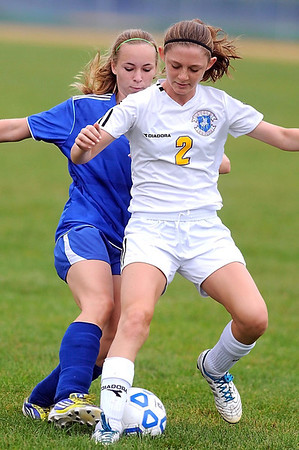 Mankato Loyola/Lake Crystal Wellcome Memorial/St. Clair's Elizabeth Ninneman (foreground) and Waseca's Hannah Quast battle for the ball during the first half of their match Saturday.