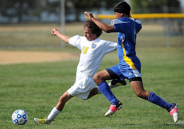 Mankato Loyola/Lake Crystal Wellcome Memorial/St. Clair's Luke VanBlarcom (left) and Waseca's Luis Castaneda chase down the ball during the first half of their match Friday.