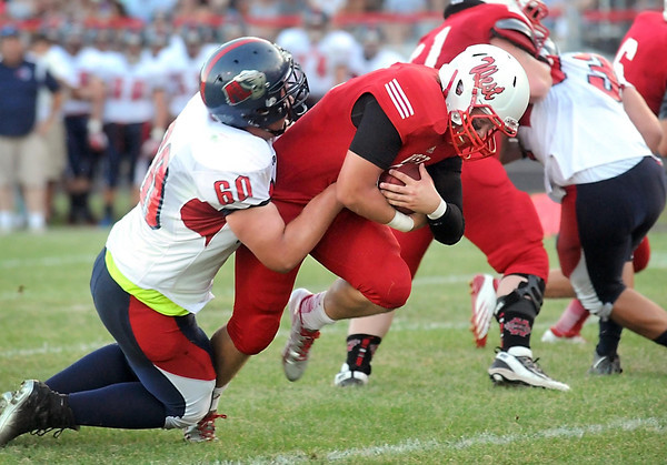 Pat Christman <br /> Mankato West's Josh Cook pushes past Albert Lea's Dustin Mattson for a touchdown during the first half Thursday at Todnem Field.
