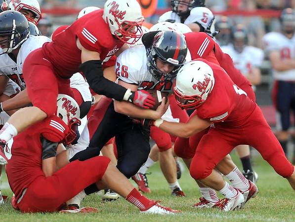 Pat Christman <br /> Albert Lea's Tim Christianson is wrapped up by the Mankato West defense during the first half Thursday.