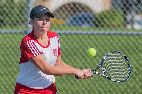 Sydney Douglas of Mankato West hits a backhand to her Woodbury opponent Elizabeth Ellington during Monday's No. 1 singles match. Photo by Jackson Forderer