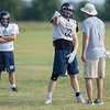 Brock Hanson (center) of St. Peter talks with a coach about the route he is running as a tight end during practice. Hanson, a senior for the Saints, plays as a tight end and inside linebacker. Photo by Jackson Forderer