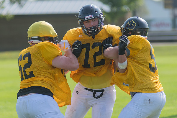 Jack Frederick of Mankato East fights through a double team while playing on the defensive line during practice. Frederick, a senior for the Cougars, will be an integral part of both the offensive and defensive lines. Photo by Jackson Forderer