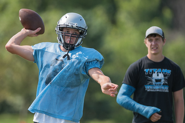 Matt Bartholomew, a senior at Tri-City United, throws a ball during practice as Peyton Collins watches. Collins, who broke his wrist, is expected to return mid-season. Photo by Jackson Forderer