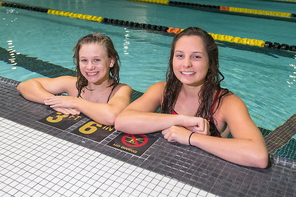 Megan Burrows (left) of Mankato East and Amanda Younge of Mankato West in the swimming pool at Mankato East. Both swimmers said it is their goal to go to the state swim meet this year. Photo by Jackson Forderer