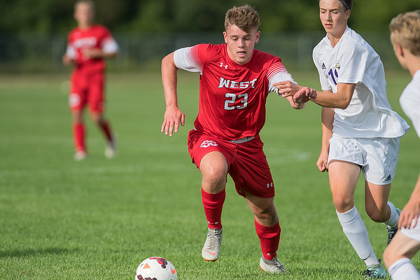 Mankato West's Zachary Franke gets past Red Wing's Owen Schauss in the first half of Tuesday's game played at Dakota Meadows. West won the game 4-2. Photo by Jackson Forderer