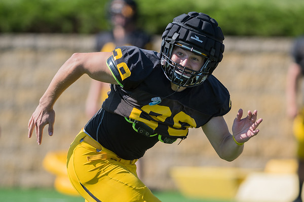 Gustavus linebacker Matt Berkner runs across the field to try to stop his offensive teammates from scoring a touchdown in a red zone drill during practice on Wednesday. Photo by Jackson Forderer