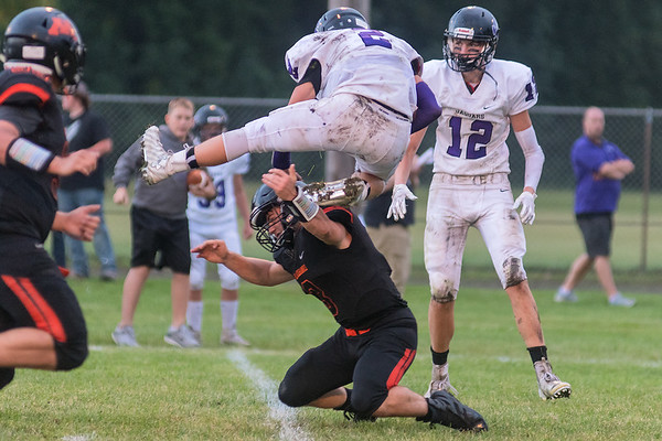 Grenada-Huntley-East Chain/Truman's Owen Wolter tries to avoid a tackle by Madelia's Logan Anderson in the first half. Wolter was not flagged for hurdling on the play. Photo by Jackson Forderer