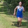 Victoria Flores of Le Sueur-Henderson runs alone in first place on the trail behind Mankato Loyola during the cross country meet held there on Thursday. Flores took first at the meet with a time of ... Photo by Jackson Forderer