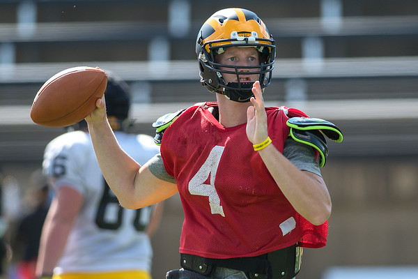Gustavus quarterback Michael Veldman scrambles out of the pocket and makes a pass to a teammate during practice on Wednesday. Photo by Jackson Forderer