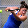 Waseca's Maddy Knoll returns a volley during a doubles tennis match with partner Katie Tlusty Saturday at the Mankato West courts. Photo by Pat Christman