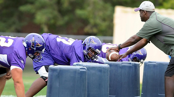 Minnesota State University linemen work through a drill during the first day of practice Saturday.