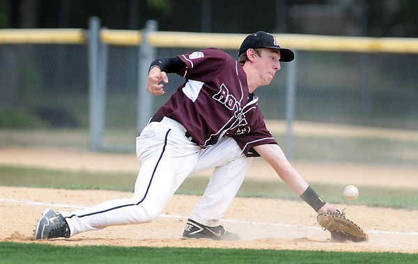 Mankato Royals VFW 950's Pat Rohlfing gets a glove on a ground ball during their first round game Thursday at Wolverton Field.