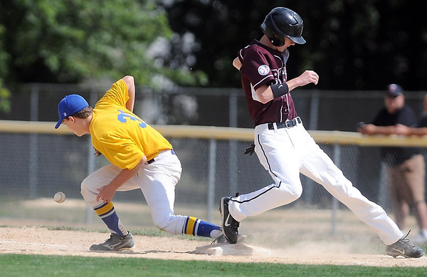 Mankato Royals VFW 950's Tyler Hatlestad makes it back to first base ahead of the throw to St. Cloud's Brady Yoerg during their opening round game in the VFW state tournament Thursday at Wolverton Field.