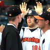 Mankato MoonDogs' Chase Simpson is congratulated by his teammates after scoring in the second inning Wednesday at Franklin Rogers Park.
