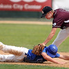 St. Cloud VFW Post 428's Andy Lenzmeier dives back to second base as Mankato Royals VFW 950's Jordan Grams tries to apply the tag during the second inning of their game Saturday at Franklin Rogers Park.