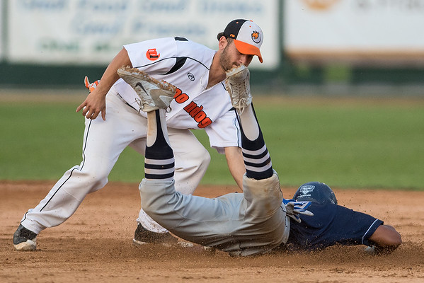 Alec Abercrombie of the Duluth Huskies is tagged out by MoonDogs second baseman Alvaro Rubalcaba at second base. The MoonDogs played their last regular season home game at Franklin Rogers Park on Wednesday. Photo by Jackson Forderer