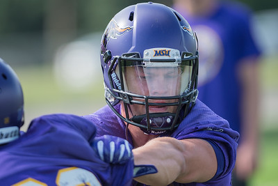 Minnesota State senior Michael Palme runs through a drill with a teammate during practice on Tuesday. Photo by Jackson Forderer