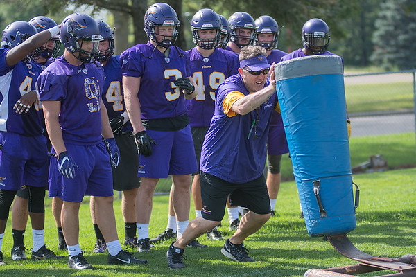 Minnesota State defensive coordinator Jim Glogowski shows players a drill on a tackle dummy during practice on Tuesday. Photo by Jackson Forderer