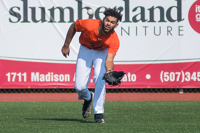Zach Hardy of the Mankato MoonDogs catches a fly ball as his teammates took batting practice on Wednesday. Hardy is a relief pitcher and attends New Mexico State. Photo by Jackson Forderer