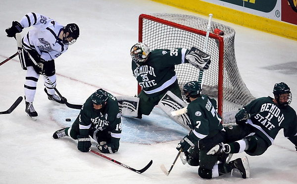 Minnesota State University's Dylan Margonari lines up a shot against Bemidji goalie Mathieu Dugas to score a goal at 4:22 of  the first period, Friday at the Verizon Wireless Center. Bemidji defenders Aaron McLoed (14), Brance Orban (7) and Graeme McCormack defend on the play.