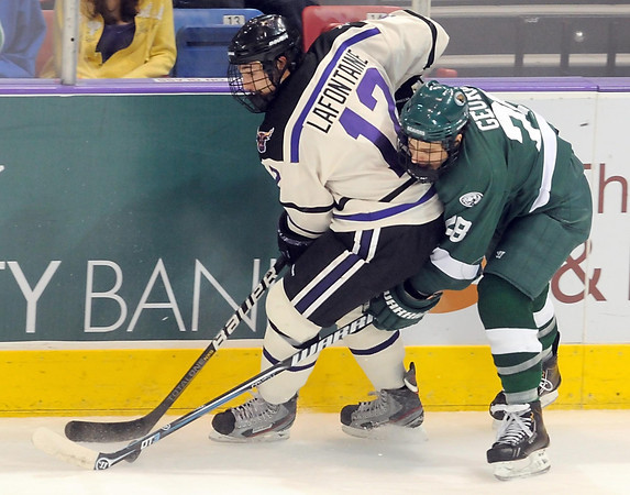 Bemidji State's Jordan George tries to tip the puck away from Minnesota State's Jean-Paul Lafontaine during the second period Saturday at the Verizon Wireless Center.