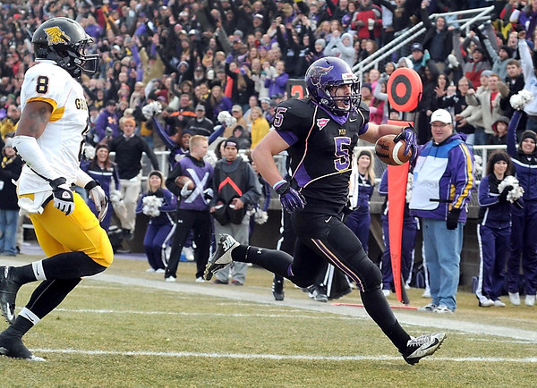 Minnesota State running back Connor Thomas beats Missouri Western State's Marc Harrison to the end zone for the game winning touchdown during their NCAA Division II football quarterfinal game Saturday at Blakeslee Stadium.