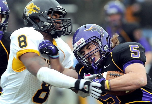 Minnesota State's Connor Thomas collides with Missouri Western's Marc Harrison during a second half run in their NCAA Division II football quarterfinal game Saturday at Blakeslee Stadium.